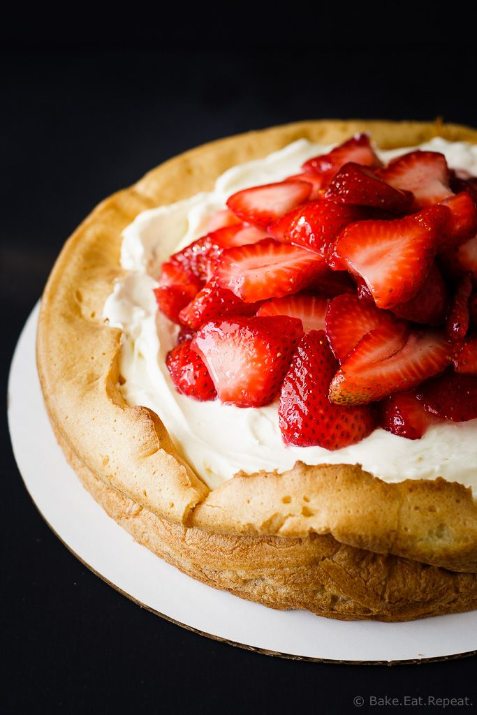 Lemon Strawberry Cream Puff Cake - A giant cream puff shell filled with lemon curd, then a creamy whipped filling and topped with fresh strawberries.