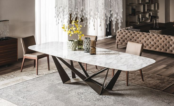 Tavolo Skorpio Keramik di CATTELAN ITALIA   Table with transparent (OP0) varnished metal base, orange fluo (FL64), white (GFM71), black (GFM73) or graphite (GFM69) embossed lacquered steel. Top in ceramic Marmi in Calacatta (KM01), Alabastro (KM02) or Ardesia (KM04). The finish of the base OP0 identifies a transparent coating on ferrous raw material.  http://www.format-store.com/en/prod/tables/tables-86/tavolo-skorpio-keramik-di-cattelan-italia.html