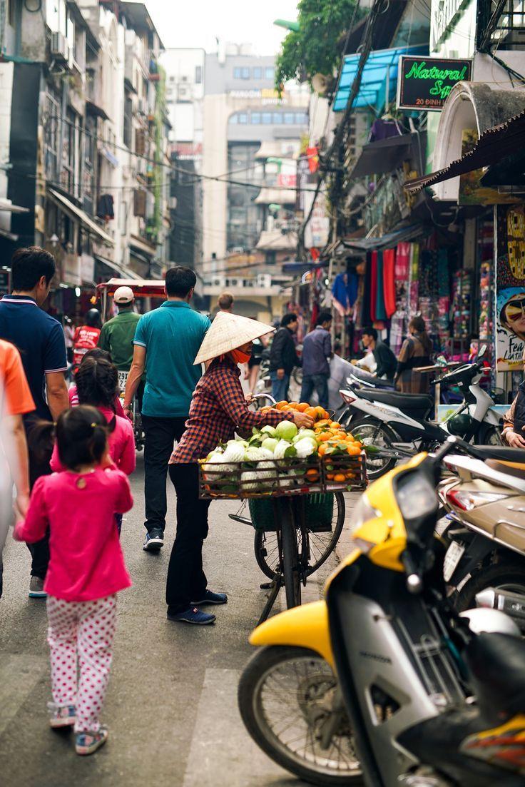 Women selling fruits on a bike in Hanoi /