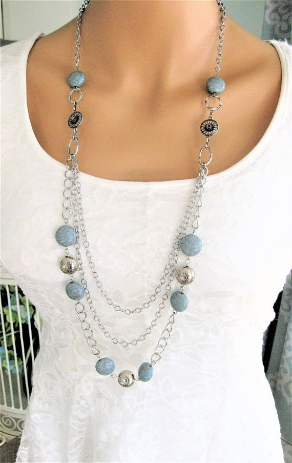 Long Light Blue Multi Strand Beaded Necklace handmade by Ralston Originals. Light blue beaded necklace made with multi strands of long silver chain, large silver rings, and blue, and silver acrylic beads. The acrylic beads make this necklace lightweight and comfortable. It is 38 inches long.  Ready to ship today.  ***SEE ALL THE BEADED NECKLACES IN MY SHOP AT: https://www.etsy.com/shop/RalstonOriginals?ref=hdr_shop_menu&section_id=21226359  ***SEE ALL THE CAMEO NECKLACES AT…