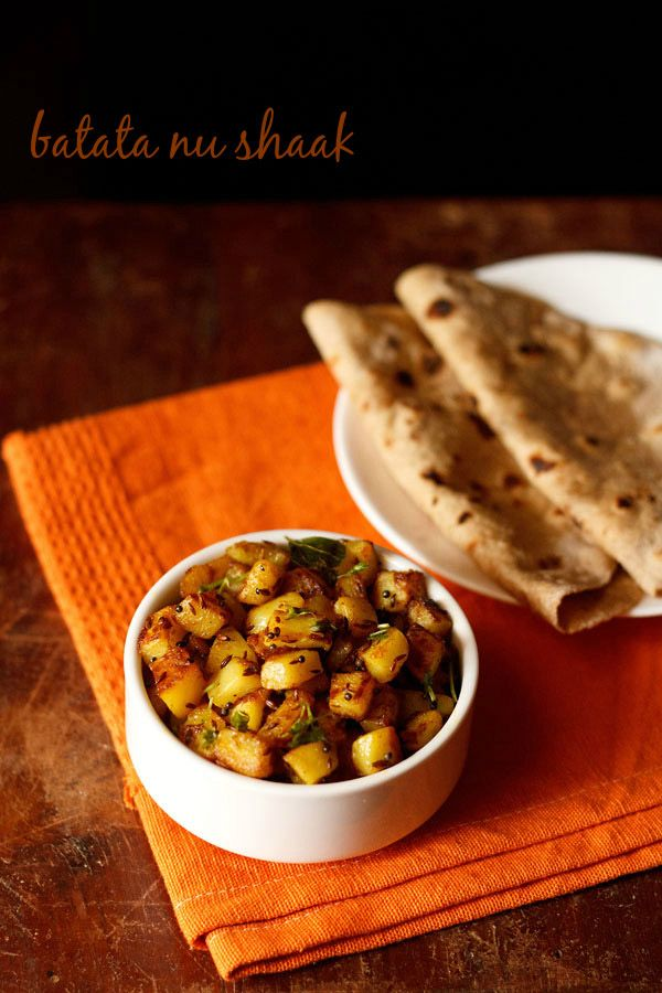 batata nu shaak recipe - spiced dry potato curry from the gujarati cuisine. step by step recipe.