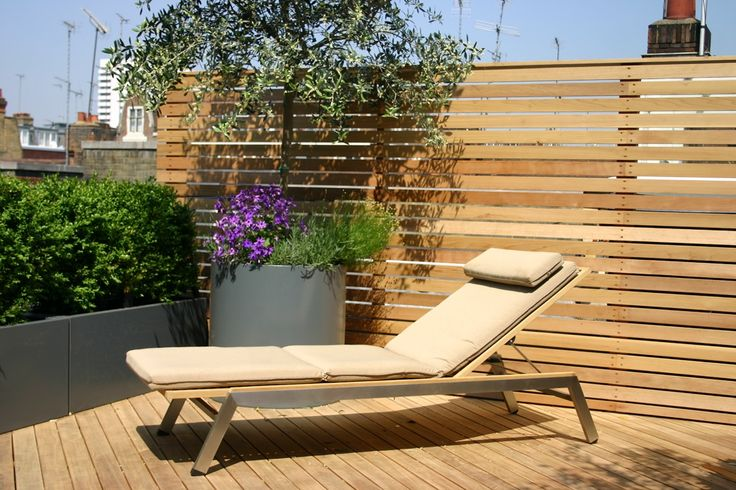 Roof Terrace Design 5 | Roof Terrace Design | Garden Design | Garden Design London | giant pot with olive next to smaller bushes & wooden fence