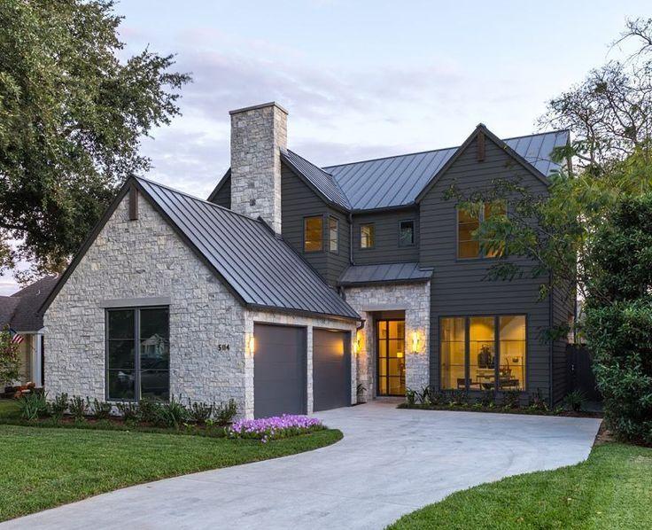 Modern Farmhouse Transitional home with stone facade, dark