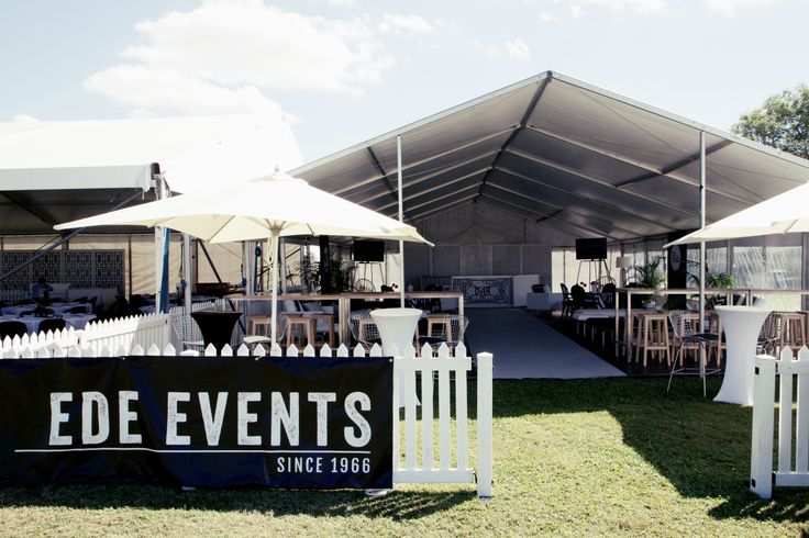 Marquee styling featuring white picket fencing and furniture for hire http://www.edeevents.com.au/marquees