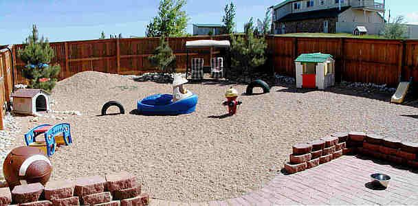 This is a nice looking play yard w/ patio, & I really like the fence (though not sure how it'd old up to being peed on over & over again).