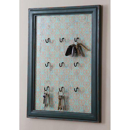 1 cadre + papier décoratif ou tissus + crochets = porte clés