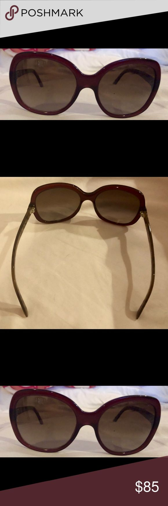 Burberry Sunglasses Gently worn authentic Burberry sunglasses. Beautiful deep maroon color with Burberry pattern on both sides. Large, fashionable frames (not polarized). Burberry case that comes with the glasses is dirty from sitting in purses, but the glasses are fine! Burberry Accessories Sunglasses