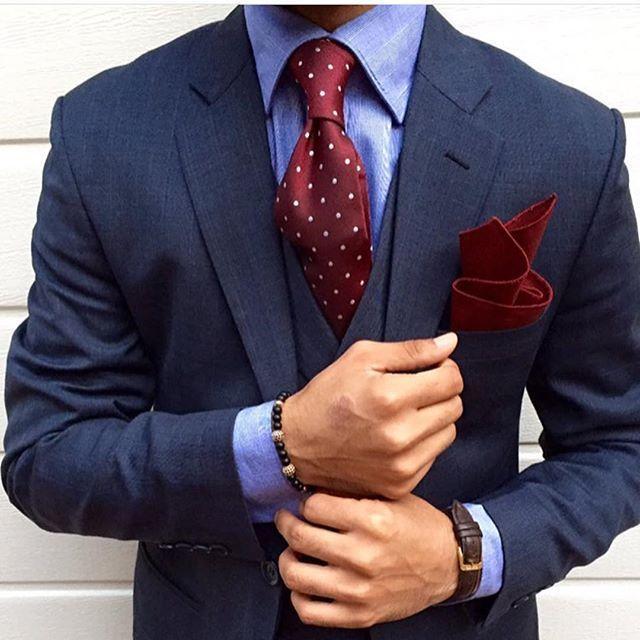 Navy suit, blue crisp shirt, burgundy polka dot tie, and pocket square