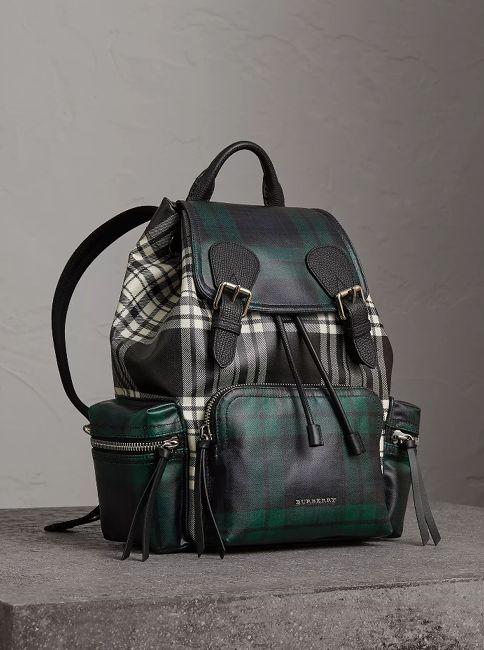 Our Burberry signature rucksack created from laminated Scottish-woven wool in clashing tartans. The easy, soft structure is influenced by military archive styles from the early 20th century and is reworked with multiple pockets for added functionality.