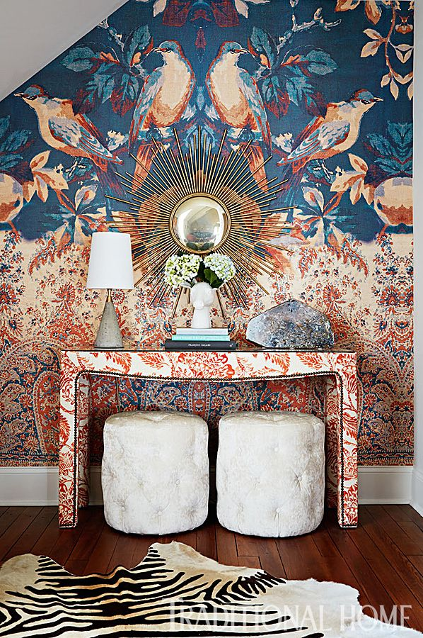 A charming mural with bluebirds brightens up an awkward wall in this room. - Photo: Werner Straube / Design: Lauren Devens