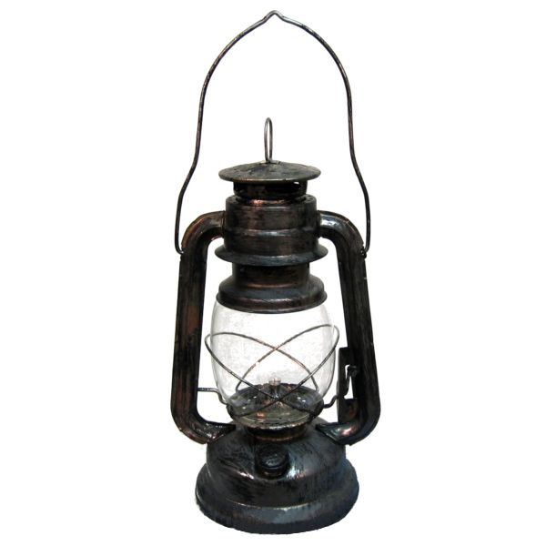 """This Rustic Lantern is Battery Operated and runs off 2 AA batteries. The Rustic Lantern Battery Operated makes a great addition to any haunted yard or even to be carried. It measures 11""""x7"""" without handle, includes a light and requires 3AA batteries and lantern cover is made of real glass."""