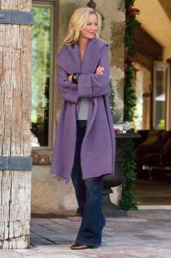 "$110.00 Telluride topper. You'll love snuggling into the exaggerated shawl collar of this so-soft, fully fashioned topper with wrist length raglan sleeves and turnback cuffs, in an attractive longer length. Lightweight but warm acrylic/mohair/wool, it's a perfectly chic layer. Misses 38"" long."