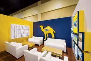 At the 2013 Duty Free Show in Orlando, Tangram created a multi-brand booth for JTI that sought to display the company's cigarette brands in a sophisticated way. An entryway showcased the different products while each of the three private meeting rooms featured a different brand and its own design.