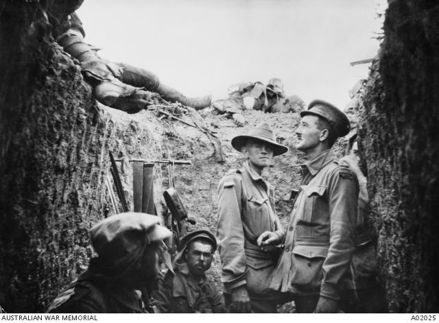 Captain Leslie Morshead in a trench at Lone Pine after the battle, looking at Australian and Ottoman dead on the parapet.  A02025 | Australian War Memorial