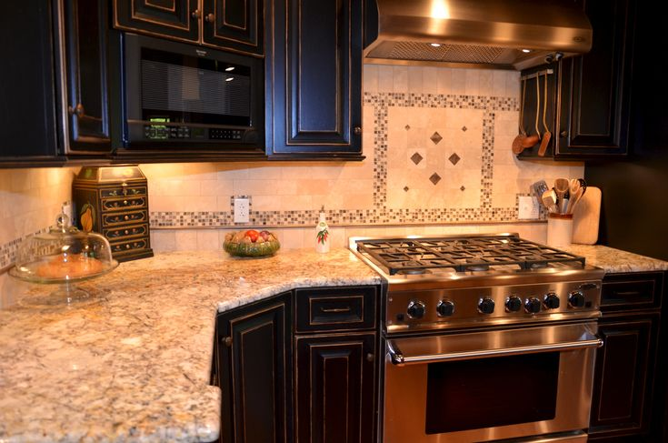 Silver Amp Gold Granite Countertops With Black Cabinets