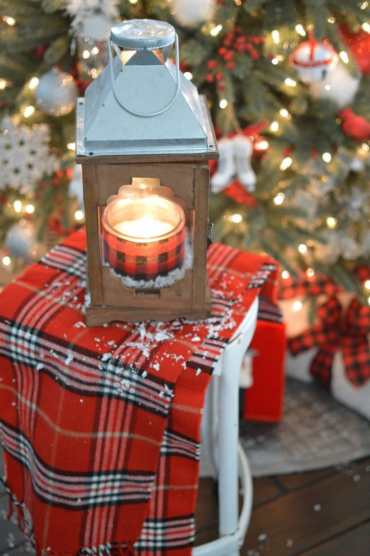 Lanterns are my go-to all season decorating favorite! (along with pillows.lol) A great trick you can do to make everyday candles match your decor is to pop some coordinating ribbon around the glass for an instant update. I just tape it in the back. Shh, don't tell. Add a little faux snow like I did to my @Homegoods lantern and it's instantly a Christmas lantern. Holiday decorating made cheaper & easier. sponsored pin