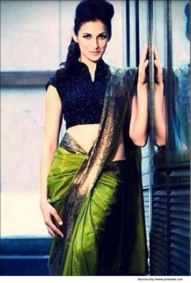 Green and navy blue silk saree with high neck navy blue glittering blouse.   #BlouseDesigns #SilkSarees