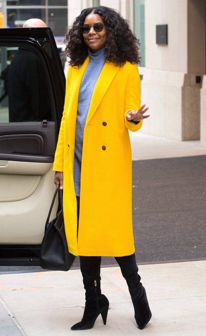 Karrueche Tran covers up in cool yellow coat as she enjoys ...