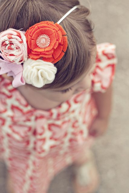 Cute headband ideas.  Flowers are made from felt, fabric, and buttons.