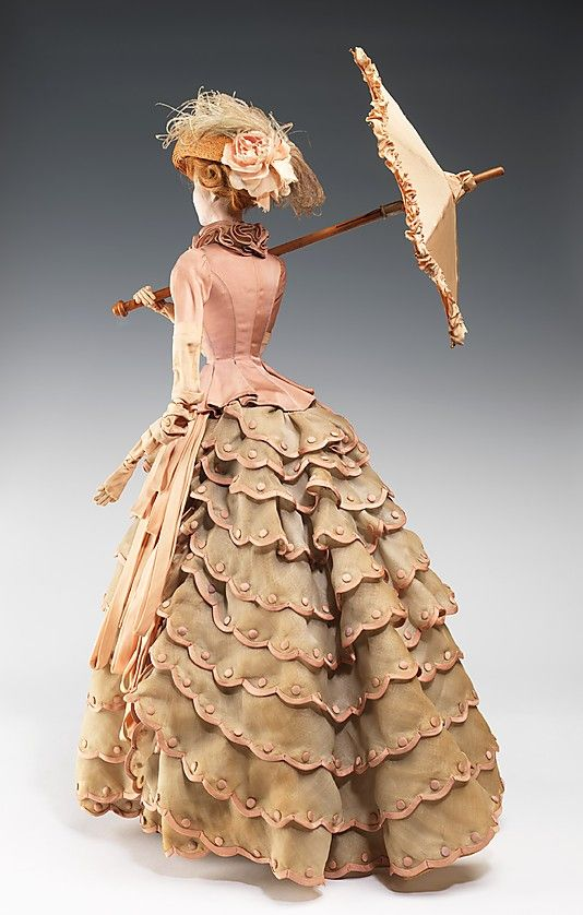 """1884 Doll"" Nina Ricci  (French, 1883–1970) Designer: Claude Saint-Cyr (French, 1911–1972) Designer: Roger Charbonnier Date: 1949 Culture: French Medium: metal, plaster, hair, silk, cotton, straw, feather, wood Dimensions: 30 3/4 x 12 1/2 in. (78.1 x 31.8 cm) Credit Line: Brooklyn Museum Costume Collection at The Metropolitan Museum of Art, Gift of the Brooklyn Museum, 2009; Gift of Syndicat de la Couture de Paris, 1949"