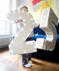 DIY Make your own life-size cardboard letters/numbers. I think these would be fun at a baseball or hockey game.