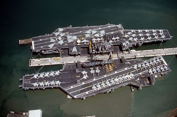 USS Midway (CV 41) and USS Independence (CV 62) in Pearl Harbor in 1991. Midway was decommissioned in 1992 and Independence in 1998.