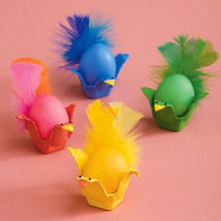 Can be made with sections of an egg carton (paper based), feathers, and eggs painted with acrylic paint.