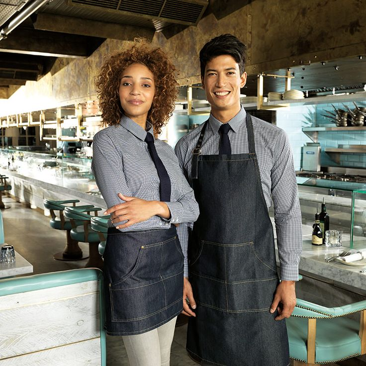 Combine our two designs of the new PR126 apron into your uniform for a unique style for your staff. Choose from a full bib or cropped waist length. Also available in black denim and indigo denim. #Premier #PremierWorkwear #Aprons #Uniform #StylishStaff #Style #Fashion #Workwear #DressingYourWorkForce #Denim #ArtisanStyle #Modern #ModernUniforms