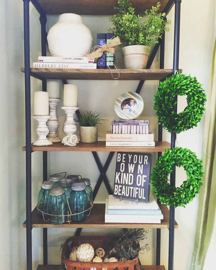 Modern farmhouse bookshelf styling || Wayfair, greenery, cream stoneware, wooden accents, tobacco baskets, artwork,