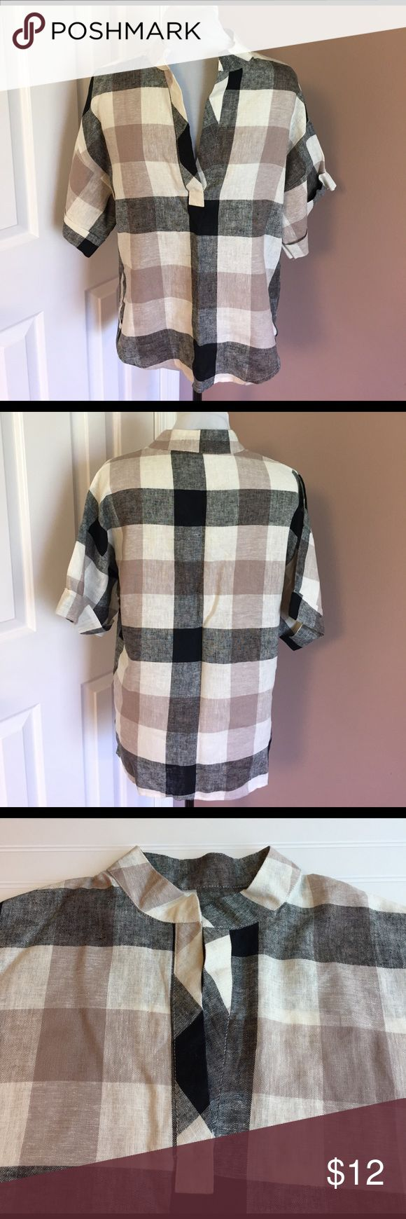 Linen Buffalo Check Top Beautiful buffalo check top.  Black, Tan and white pattern in linen fabric.  Mandarin collat.  8 in split placket. Short sleeves with cuff.  Top is 25 in long in front, 2 in longer in back.  Bust is 42in. As are the hips for a loose fit. Never worn. Perfect condition.  Smoke free. Tops