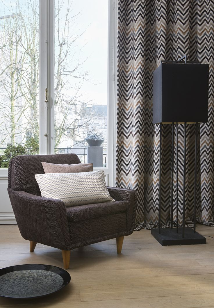 Always balance sombre coloured upholstery with curtains that have eye-catching zig-zag prints or patterns. It adds a dash of personality to your living room.   #DDecor #PlanetEarth #DDecorDiaries  #AsYouLikeIt
