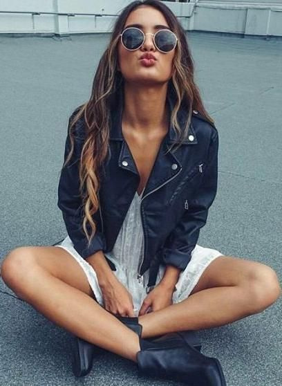 moto jacket. round sunglasses. white lace dress. ankle boots.