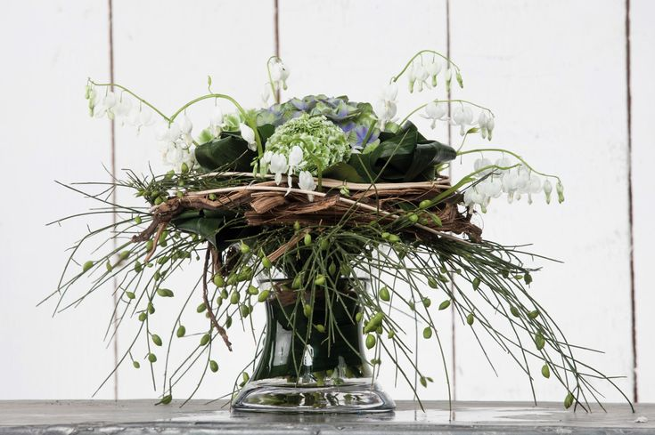 "Bouquet ""First Class""- a beautiful rustic bouquet with a wreath of grapes wood with lovely heart-shaped Dicentris Hydrangea Ranunculus and broom.~ Binnema Bloemen, Heerenveen Sneek"
