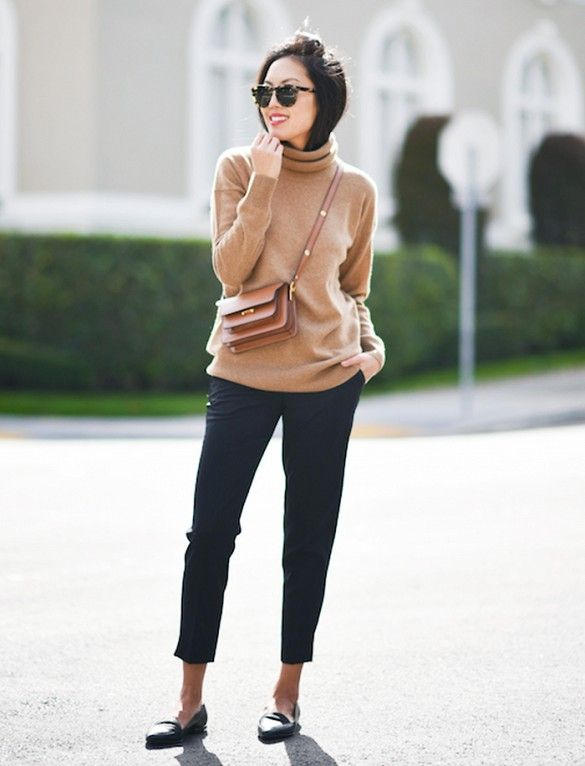 A turtleneck is worn with cropped trousers, loafers, and a crossbody bag