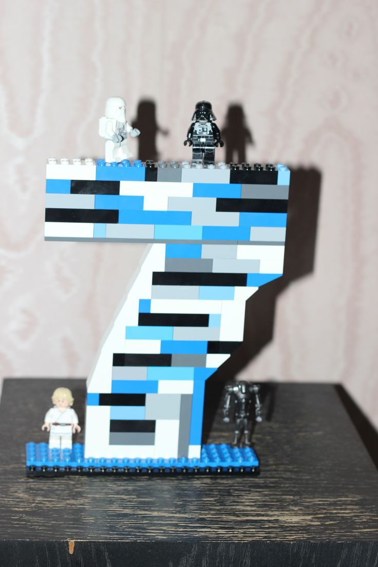 Birthday number seven Lego figurine with Star Wars mini-figures for LEGO Star Wars boys party. More ideas at https://instagram.com/planit_group