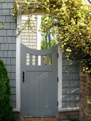 Side gate idea, maybe paint our side gate the same color as our house and leave the rest of the fence natural??