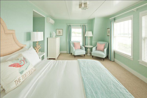 Tides Beach Club - Contemporary cottage style bedroom features seafoam gree