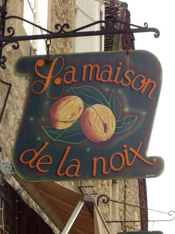 """Sign """"La Maison de la Noix"""", (Nut Store), Rocamadour, Lot, France."""