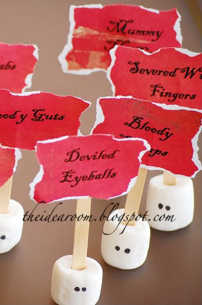 Halloween - I just took some large marshmallows and added eyes with a Sharpie. Then I just printed the name of the food item on some red scrapbook paper and tore it around the edges and attached it to a popsicle stick which I inserted into the marshmallow.