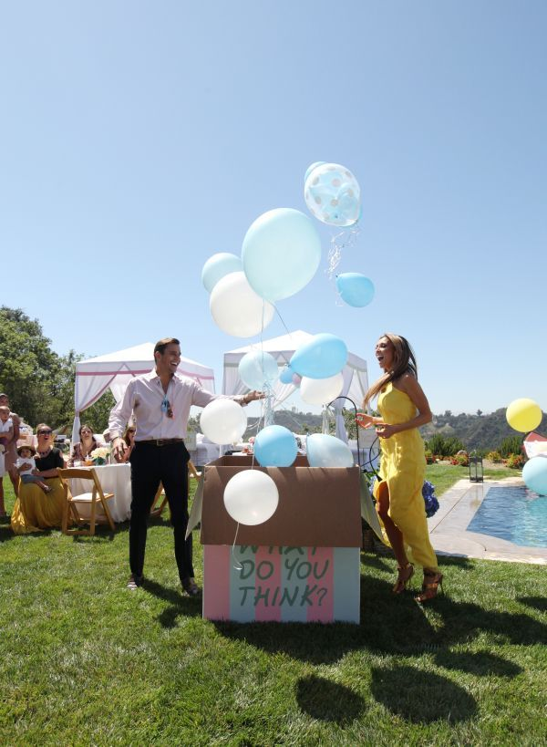 Bill + Giuliana's Gender Reveal Baby Shower. Love the balloon box reveal + white wire seating area //