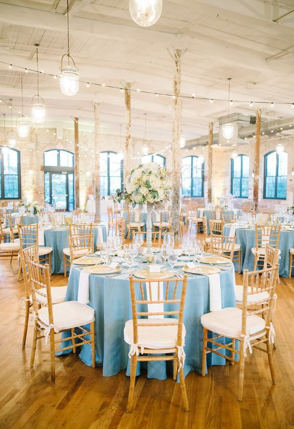 Sky blue tablecloths, gold chiavari chairs, classic décor meets industrial setting // Aaron and Jillian Photography