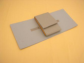 Bücher für Versand verpacken - Mit Pappe als Büchersendung