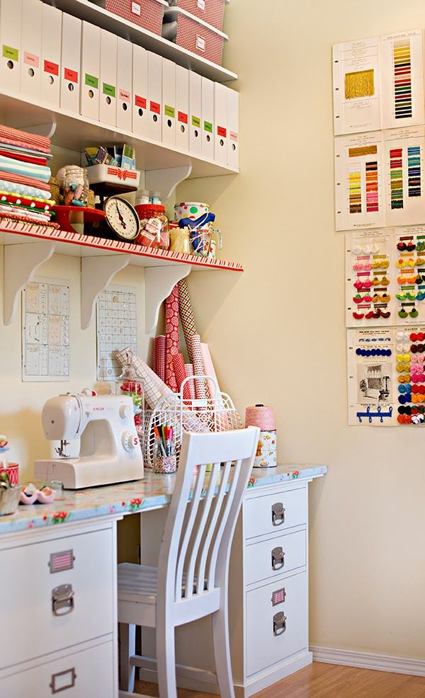shelves with brackets, plastic containers with pretty fronts and stickers. oilcloth covered desk.