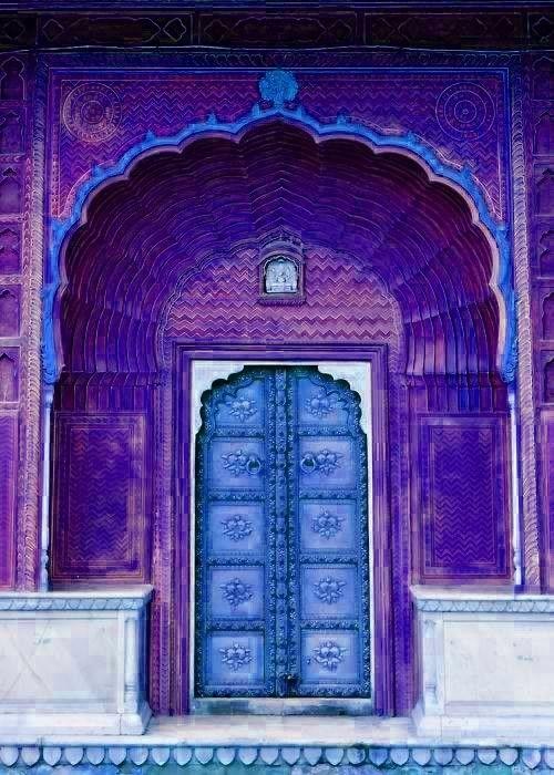 Ornate blue & purple door.