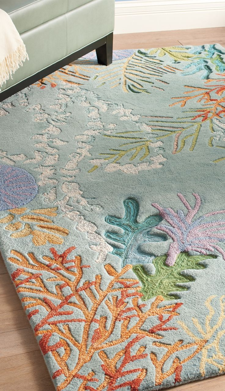 Take the plunge and add this gorgeous wool rug to your home's décor. With a design like a deep sea adventure, you'll enjoy the flora and fauna a coral reef under your feet.