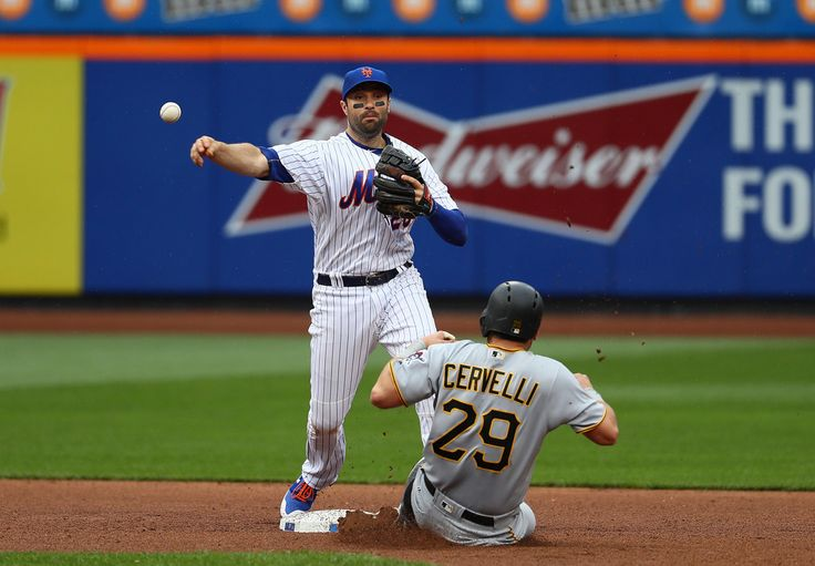 Francisco Cervelli Photos Photos - Neil Walker #20 of the New York Mets ttempts to turn a double play against Francisco Cervelli #29 of the Pittsburgh Pirates during their game at Citi Field on June 4, 2017 in New York City. - Pittsburgh Pirates v New York Mets