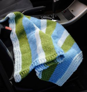 A knit blanket should be one of those essentials you keep in your car. This pattern rolls up neatly and buttons closed for easy storage in the backseat, trunk or almost any compartment.
