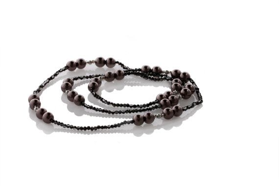 Glass Pearl Deep Burgundy Silver and Crystal Long Handmade Necklace - Code: KTC-323    Love the simplicity of this glass 8mm pearl in a burgundy brown silver with 3mm faceted crystals in black AB continuous necklace. No clasp.    Very easy to wear this 95cm necklace with anything. You will be delighted to wear it with jeans for the casual look or dress it up with your elegant dress.    Code KTC-323    (Colours may vary from screen to screen depending on settings)…