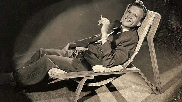 Brooklyn-born, life-long New Yorker. A Coast Guard veteran with a cabaret act. A self-taught furniture designer/maker. Inventor of modular seating for post-war Americans. Lover of rosewood, mahogany, and rich lacquer accents and upholstery. Famous posthumously. Cool dude.