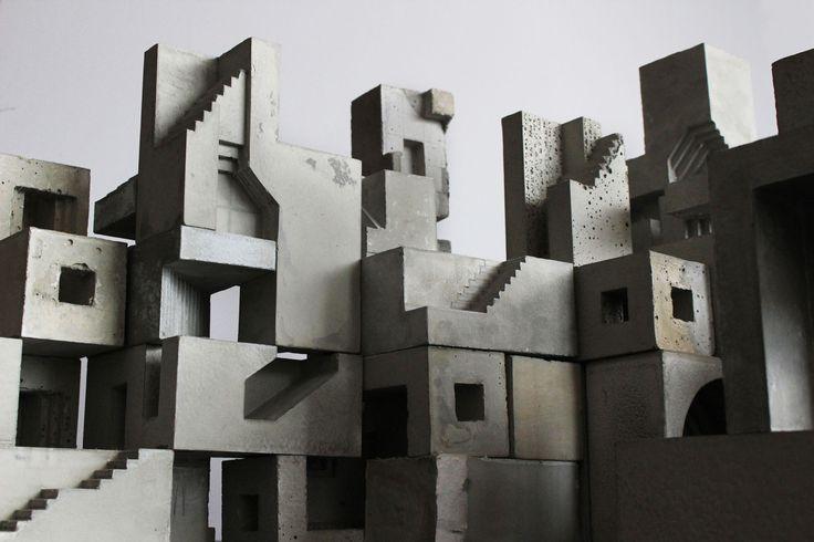 Art installation. Miniature city made in concret blocs.